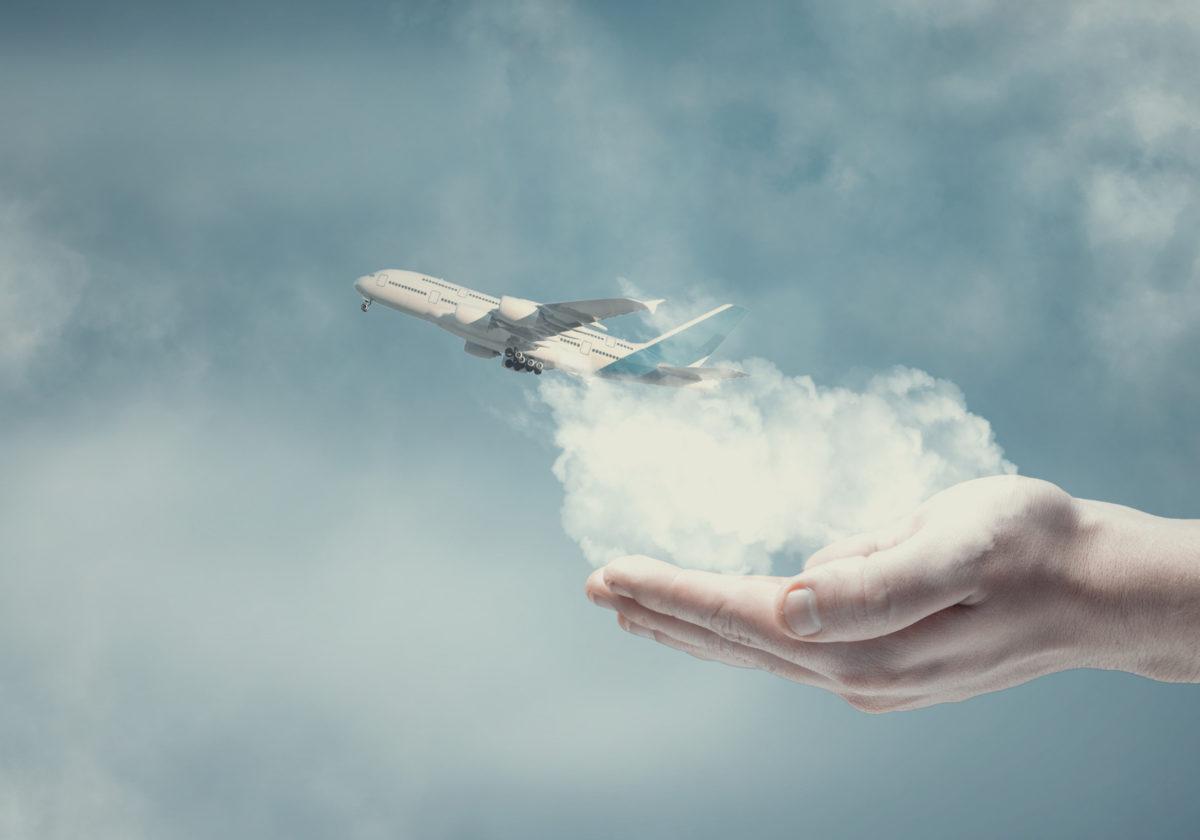 hand-airplane-sky