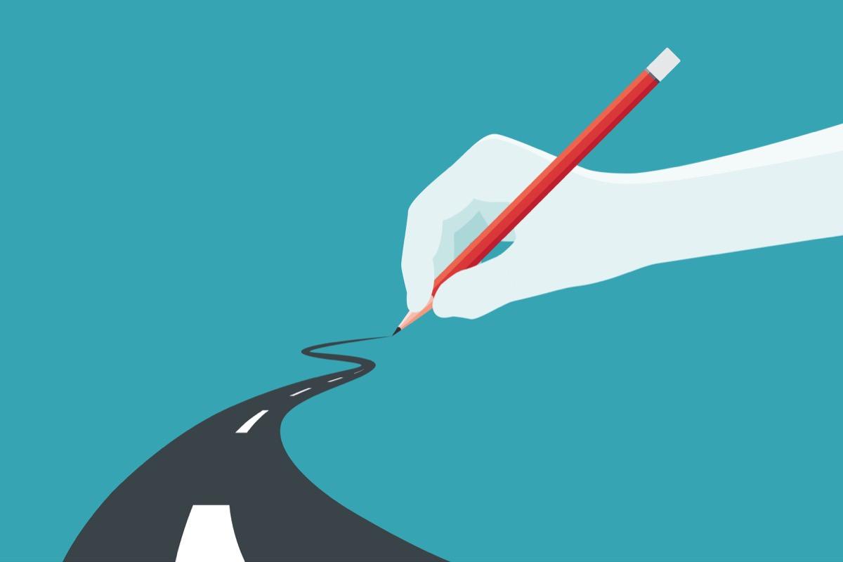 hand-pen-road